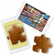 Gingerbread puzzle piece, with promotional card in flowpack