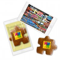 Gingerbread puzzle piece mit Logo, with promotional card in flowpack